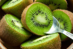 Juicy ripe kiwi fruit in wooden bowl with spoon. Juicy ripe green kiwi fruit Royalty Free Stock Photography