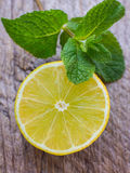 Juicy ripe lemon and mint Royalty Free Stock Photo