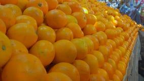 Juicy ripe mandarin in the fruit market. Juicy ripe mandarines on beautifully decomposed showcase in the fruit market stock footage