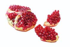 Juicy ripe open pomegranate piece Royalty Free Stock Photo