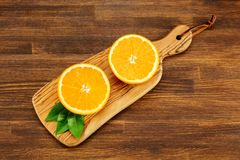 Juicy ripe oranges on wooden background, top view Stock Photo