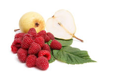 Juicy,ripe pears and raspberries on a white. Stock Images