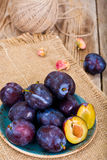Juicy Ripe Plums on Woody Background Stock Photography