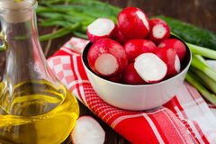 Juicy ripe radish in a bowl and other ingredients. Food closeup Royalty Free Stock Images