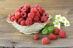 Juicy ripe raspberries with mint leaves Royalty Free Stock Images