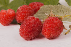 Juicy ripe raspberries. Some ripe and juicy raspberries are on the table Royalty Free Stock Photos