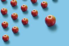 Juicy ripe red apples on a blue pastel background. Minimal concept stock photo