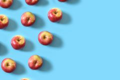 Juicy ripe red apples on a blue pastel background. Minimal concept royalty free stock images