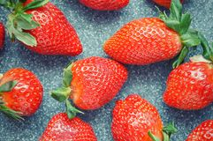 Juicy ripe strawberry on grey background royalty free stock images
