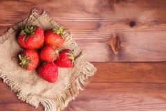 Juicy ripe strawberry linen napkin. Juicy ripe strawberry on wood table on linen napkin Royalty Free Stock Photography