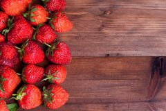 Juicy ripe strawberry on wood Stock Images