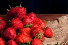 Juicy ripe strawberry. On wood tableon linen napkin Royalty Free Stock Image