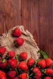 Juicy ripe strawberry. On wood tableon linen napkin Royalty Free Stock Photography