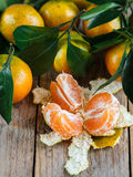 Juicy ripe tangerines with leaves on the table. Mandarin Royalty Free Stock Images