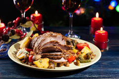 Juicy roast pork on the holiday table Royalty Free Stock Photography