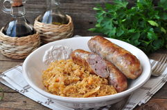 Juicy Roasted Bavarian sausages with the stewed cabbage Stock Photos