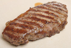 Juicy Sirloin Steak. Char-grilled sirloin steak resting on a plate Royalty Free Stock Image