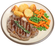 Juicy Sirloin Steak Dinner. Juicy sirloin steak with roast potatoes, peas and carrots Royalty Free Stock Images
