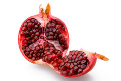 Juicy sliced pomegranate. On a white background royalty free stock images