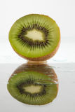 Juicy sliced reflected kiwi Stock Image