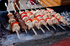 Juicy slices of meat  prepare on fire Stock Images