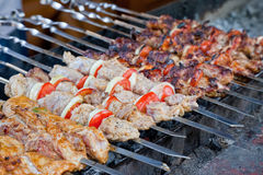 Juicy slices of meat with sauce prepare on fire. (shish kebab stock photos