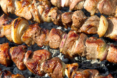 Juicy slices of meat with sauce prepare on fire Royalty Free Stock Image