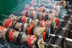 Juicy slices of meat with sauce prepare on fire shish kebab.  stock photography