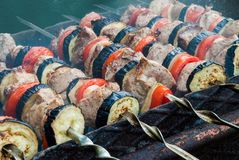 Juicy slices of meat with sauce prepare on fire shish kebab.  royalty free stock photos
