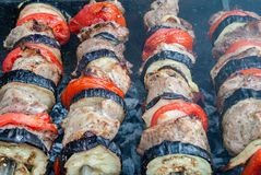 Juicy slices of meat with sauce prepare on fire shish kebab.  stock photo