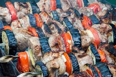 Juicy slices of meat with sauce prepare on fire shish kebab.  royalty free stock photo