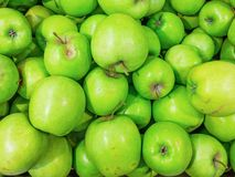Green ripe apples in the store royalty free stock image