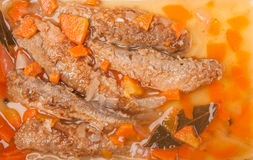 Juicy snack a roast pickled smelt with carrot Royalty Free Stock Photography
