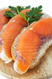 Juicy snack from slices salmon. Juicy snack from slices salty salmon and crispbread Royalty Free Stock Photography