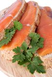 Juicy snack from slices salmon. Juicy snack from slices salty salmon and crispbread Royalty Free Stock Image