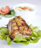 Juicy steak. Roasted rib steak with fresh salad on a white background Royalty Free Stock Photography