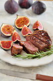 Juicy steak with figs Stock Image