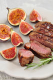 Juicy steak with figs Stock Photos