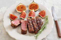 Juicy steak with figs Royalty Free Stock Photography