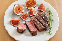 Juicy steak with figs Stock Images