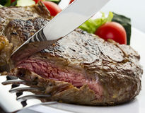 Juicy steak. With fork and knife Royalty Free Stock Photography