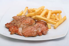 Juicy steak with french fries Stock Image