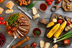 Juicy steak grilled with different grilled vegetables Stock Photography