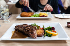 Juicy Steak Meal Served With Fresh Vegetables Stock Photo
