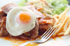 Juicy steak meat with french fries and fried eggs Royalty Free Stock Image