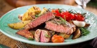 Juicy steak medium rare beef with spices. stock image