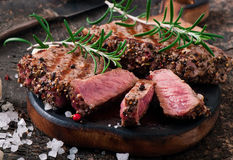 Juicy steak medium rare beef. With spices Stock Photos