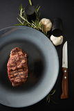 Juicy steak medium rare beef with spices Stock Photography