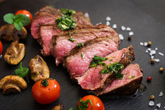 Juicy steak medium rare beef with spices Stock Photos