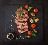 Juicy steak medium rare beef with spices Royalty Free Stock Image